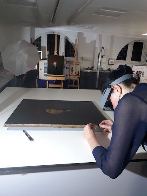 Colour photograph showing Christina Young, principal investigator of the PISTACHIO project, at work during an analytical study of portraits attributed to Raeburn