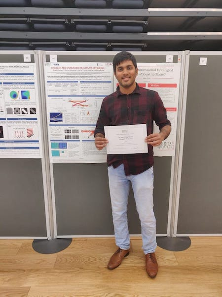 Colour photograph showing Anchit holding his prize certificate for the 1st Year Postgraduate Prize from Heriot-Watt University whilst standing next to his poster outlining his research for the PISTACHIO project (copyright Anchit Srivastava)